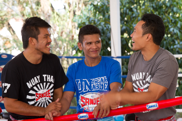 Muay Thai trainers having a joke Sumalee Thailand